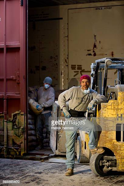 Workers Unloading Cargo Container