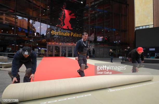 Workers unroll the red carpet outside the Berlinale Palace prior to the 70th Berlinale International Film Festival on February 18, 2020 in Berlin,...