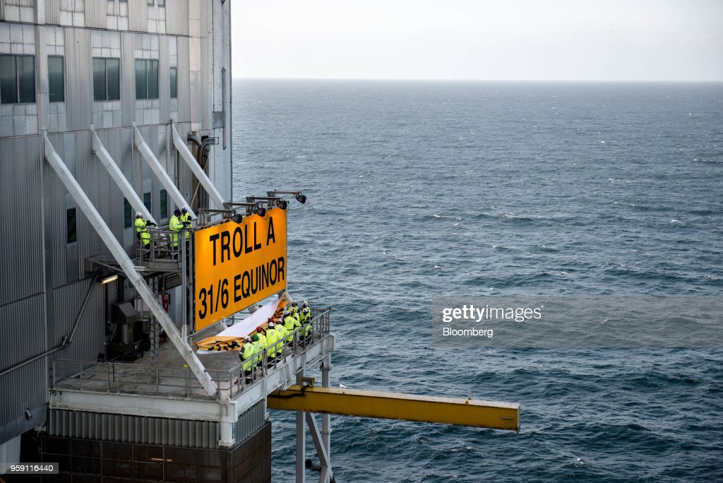 Workers unveil the new Equinor name on the Troll A natural gas platform, operated by Equinor ASA, in the North Sea, Norway, on Wednesday, May 16, 2018. Statoil has changed its name toEquinorto reflect its mutation into a broader energy company.Photographer: Carina Johansen/Bloomberg via Getty Images