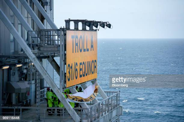Workers unveil the new Equinor name on the Troll A natural gas platform operated by Equinor ASA in the North Sea Norway on Wednesday May 16 2018...