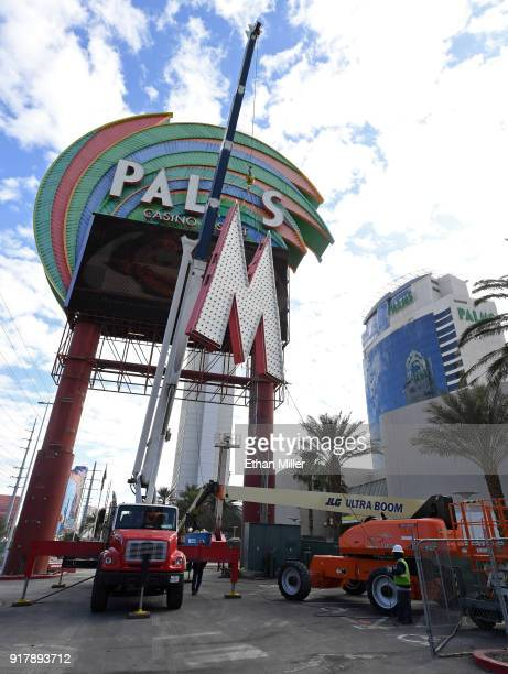 Workers use a crane to remove the 14-foot-tall letters on the Palms Casino Resort marquee as the sign is deconstructed as part of a USD 485 million...