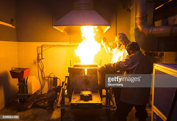Workers use a furnace to melt gold during the casting of gold ingots at the Suzdal gold mine operated by Nordgold NV in Semey Kazakhstan on Tuesday...