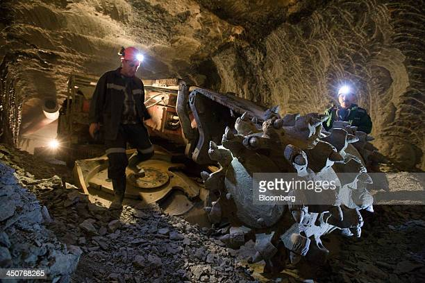 Workers use a rock cutting machine to excavate diamond rock ore in OAO Alrosa's Mir diamond mine in Mirny Russia on Wednesday Nov 13 2013 OAO Alrosa...