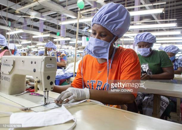 Workers use sewing machines to assemble a piece of personal protective equipment for COVID-19 coronavirus frontline health workers at a factory...
