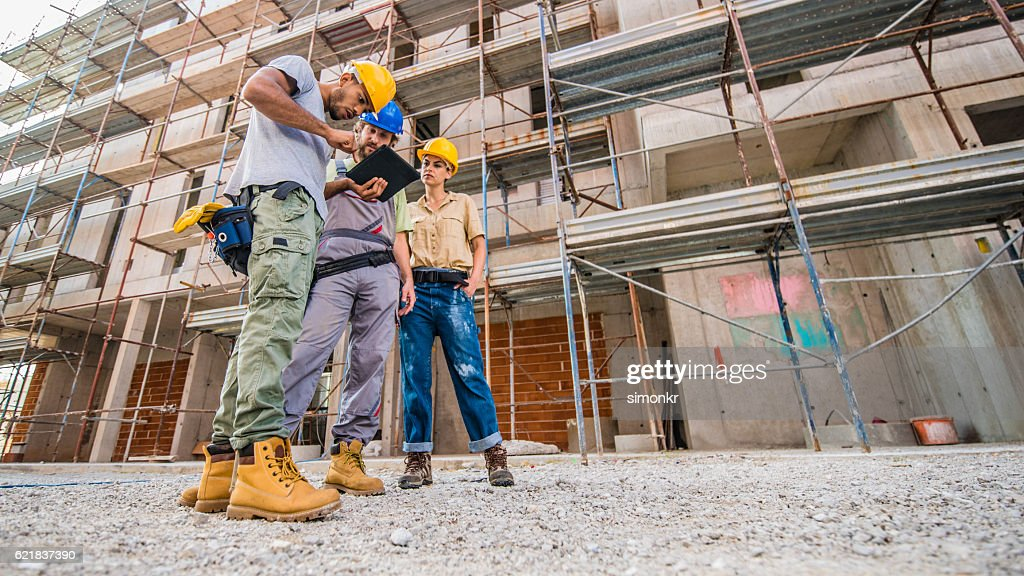Workers using digital tablet : Stock Photo