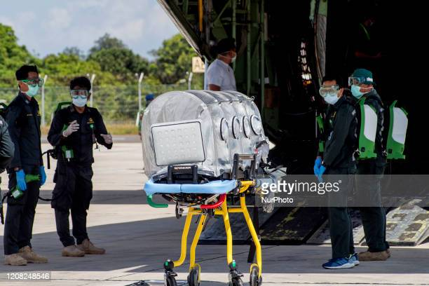 Workers using heavy equipment lift medical equipment to be used for Corona Special Hospital at Hang Nadim Airport in Batam Riau Islands on March 12...