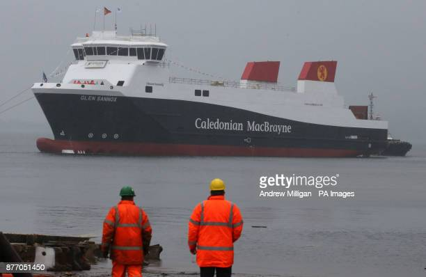 Workers view the ferry MV Glen Sannox after it was launched at a ceremony for the liquefied natural gas passenger ferry the UK's first LNG ferry at...