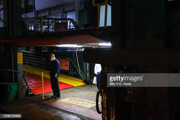 Workers wait at the pier during a coronavirus outbreak on March 26 2020 in Hong Kong China Latest statistics showed Hong Kong tourist arrivals plunge...
