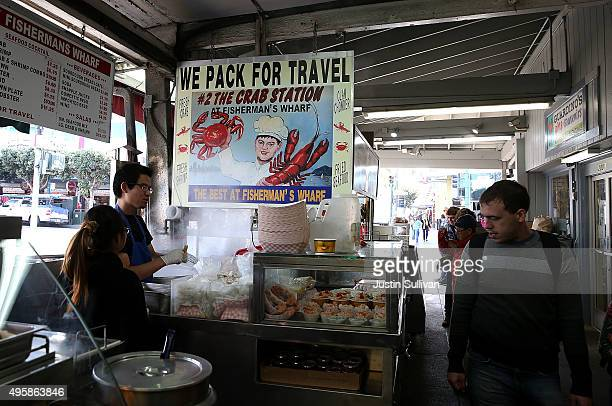 Workers wait for customers at The Crab Station At Fisherman's Wharf on November 5 2015 in San Francisco California The California Fish and Game...
