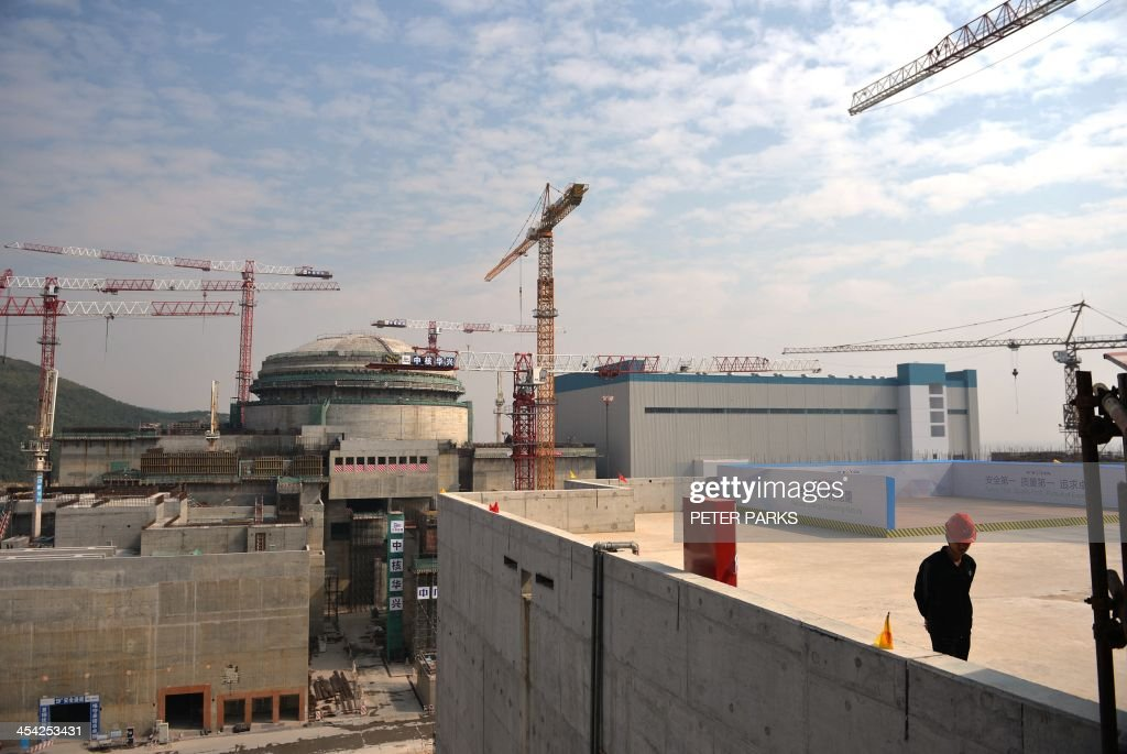 Workers wait for French Prime Minister Jean-Marc Ayrault to arrive at the joint Sino-French Taishan Nuclear Power Station outside Taishan City in Guandong province on December 8, 2013. French Prime Minister Jean-Marc Ayrault touted his country's nuclear expertise during his visit to China -- the world's largest market for atomic power stations. AFP PHOTO/Peter PARKS