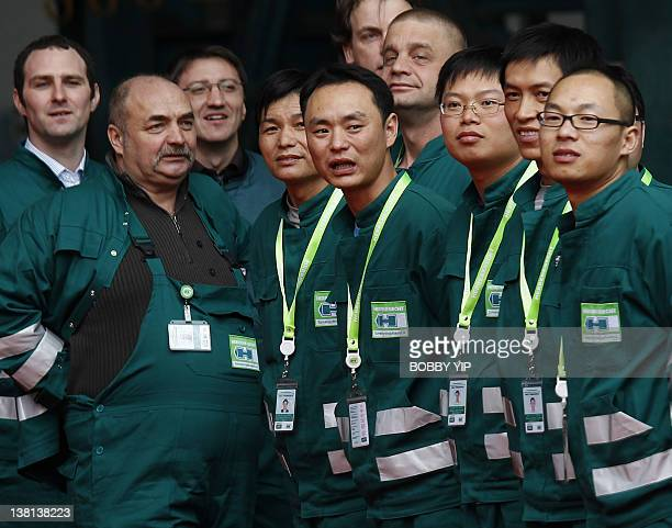 Workers wait for the arrival of German Chancellor Angela Merkel and Chinese Premier Wen Jiabao at a plant of Herrenknecht Tunnelling Equipment Co Ltd...