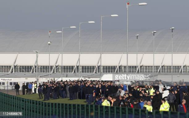 Workers wait for the arrival of the Airbus BelugaXL supertransporter aircraft at Hawarden Airport near the Airbus SE plant in Broughton UK on...