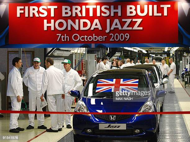 Workers wait for the launch of the first British built Honda Jazz family supermini to leave the production line at the Honda car plant in Swindon...