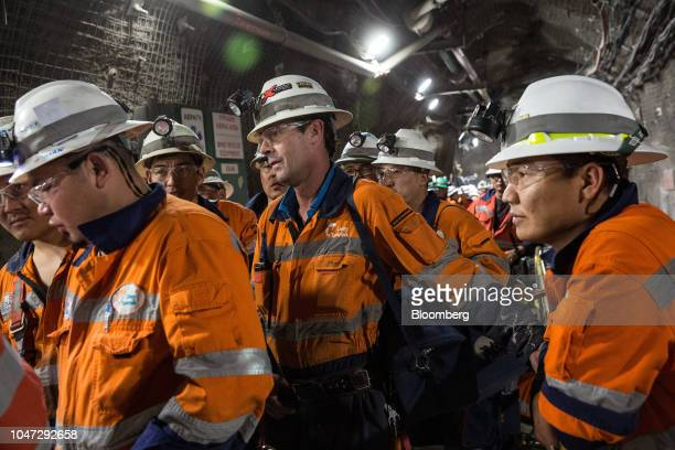 Workers wait in line for an elevator following a shift in the underground mining project at the Oyu Tolgoi coppergold mine jointly owned by Rio Tinto...