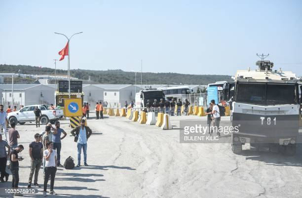 Workers wait near the police barricade at the entrance of Istanbul new airport building site on September 15 in Istanbul Turkish police have detained...