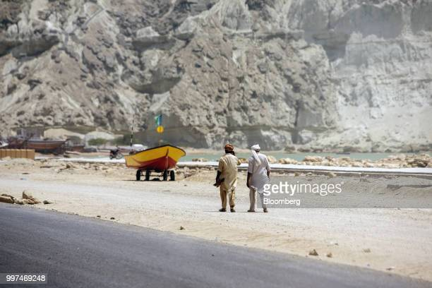 Workers walk along a road on Marine Drive in Gwadar Balochistan Pakistan on Tuesday July 4 2018 What used to be a small fishing town on the...