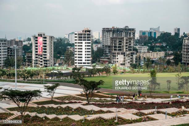 Workers walk at the Friendship Square in the city of Addis Ababa, Ethiopia, on September 22, 2020. - For the past year, workers have been busy...