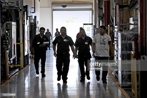 Workers walk in a hallway at the Turbotec turbine refurbishing and assembly plant in Tijuana Mexico on Monday Oct 11 2010 Production at Mexican...