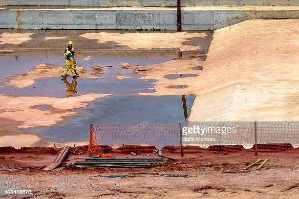 Workers walk inside the Deodoro Sports Complex for the Rio 2016 Olympic Games in Ricardo de Albuquerque neighborhood on April 2 2015 in Rio de...