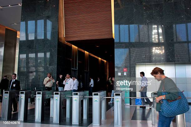 Workers walk inside the Ventura Corporate Towers development a joint real estate project between Camargo Correa Desenvolvimento Imobilario SA and...