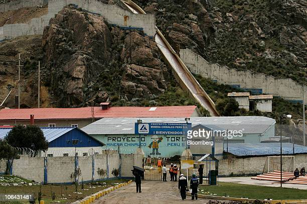 Workers walk near the entrance to Chinalco's temporary base of mining operations at the Toromocho Project in Morococha Peru on Monday April 5 2010...