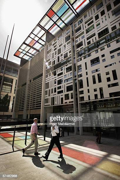 Workers walk near The Home Office in Marsham Street on April 28 2006 in London Home Secretary Charles Clarke will update Parliament today on the hunt...