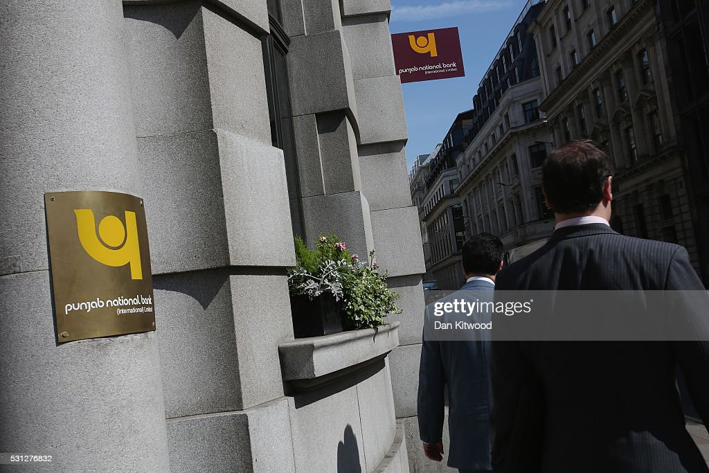Workers walk past the Punjab National Bank in the City of London on May 13 2016 in London England There are 250 foreign banks set up in the UK...