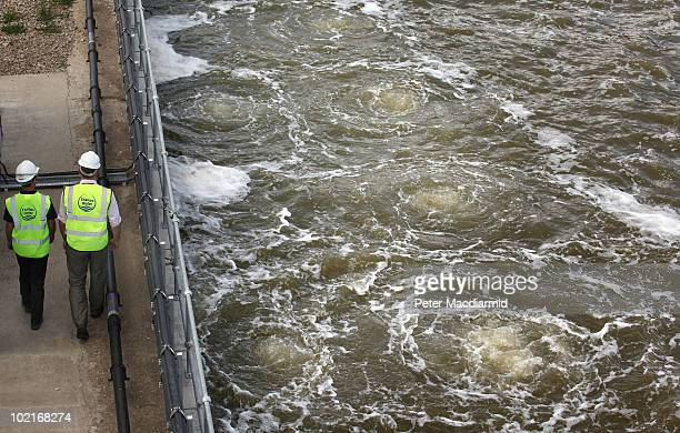 Workers walk past water swirling in salinity tanks at Britain's firstever mainland desalination plant which is known as the Thames Gateway Water...
