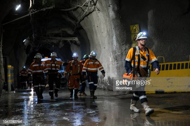 Workers walk through a tunnel towards elevators following a shift in the underground mining project at the Oyu Tolgoi coppergold mine jointly owned...