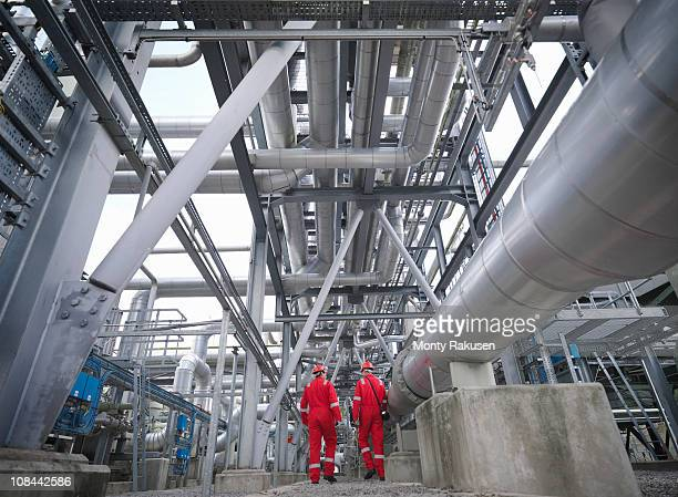 Workers walk through an underground gas