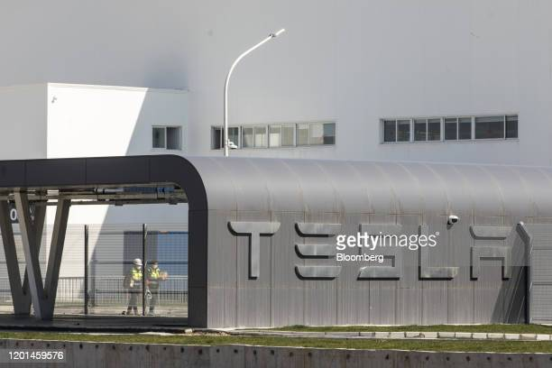 Workers walk through the Tesla Inc Gigafactory in Shanghai China on Monday Feb 17 2020 Tesla has fully resumed deliveries of its Chinabuilt model 3...