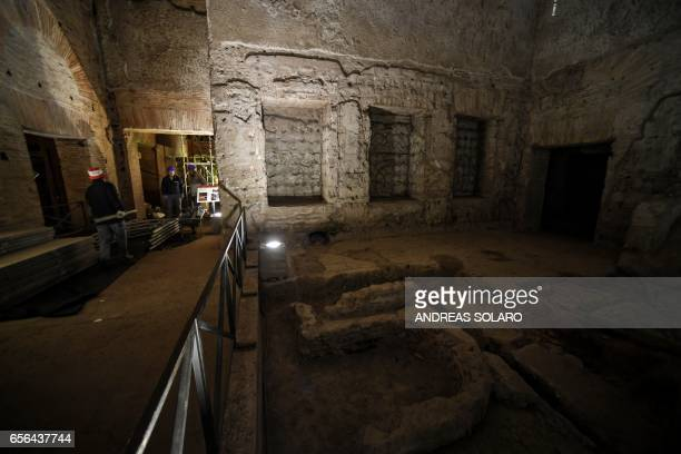 Workers walk through through one of the rooms of the Domus Aurea a large palace built by the Roman Emperor Nero in the first century during a...