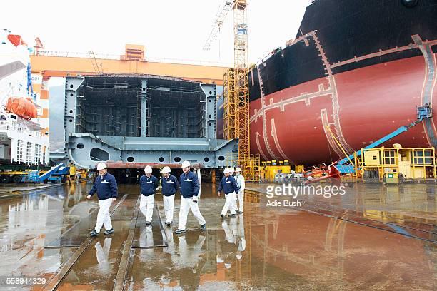 Workers walking across shipyard, GoSeong-gun, South Korea