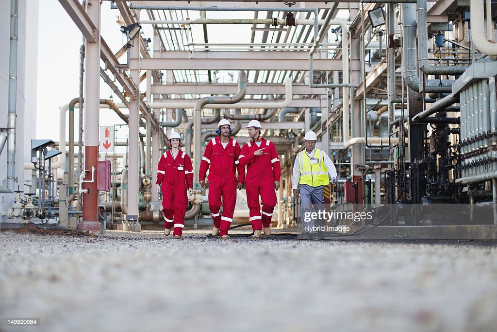 Workers walking at chemical plant : Stock Photo