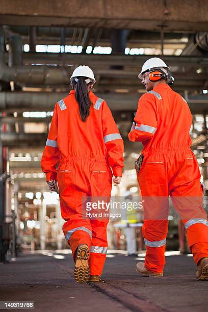 Workers walking at oil refinery