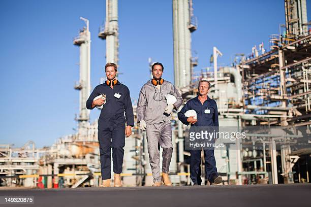 workers walking at oil refinery - after work stock pictures, royalty-free photos & images