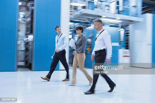 Workers walking in factory