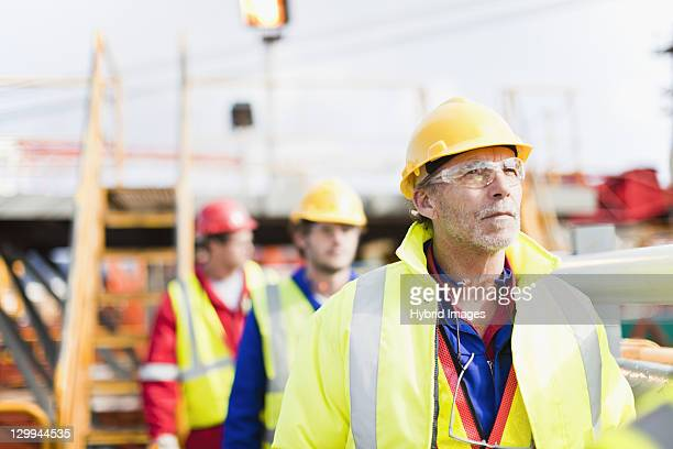 workers walking on oil rig - power occupation stock photos and pictures