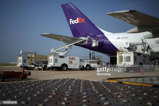 Workers wash a plane at the FedEx Corp hub in Memphis Tennessee US on Wednesday Sept 18 2013 FedEx Corp reported firstquarter profit that beat...