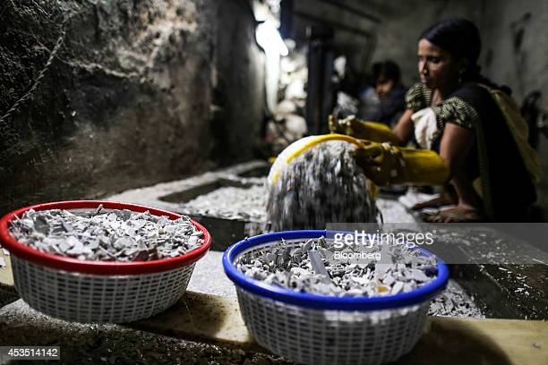 Workers wash shredded plastic waste for recycling in the Dharavi slum area of Mumbai, India, on Monday, Aug. 11, 2014. Almost a year after Reserve...