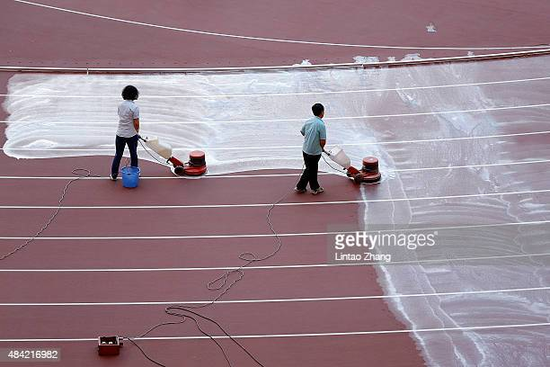 Workers wash the track at the China National Stadium also known as Bird's Nest on August 16 2015 in Beijing China 15th IAAF World Championships will...
