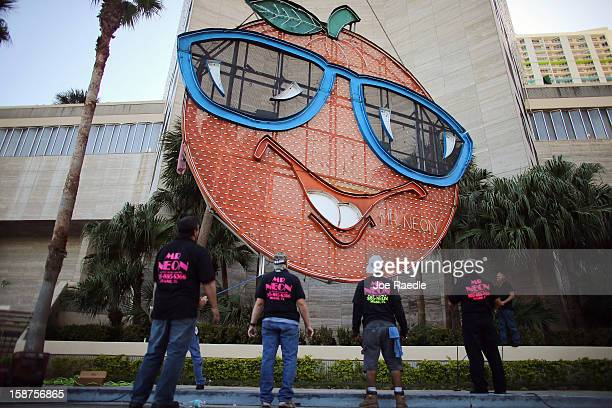Workers watch as the Big Orange a New Year's time ball is prepared to be raised onto the side of the Hotel InterContinental on December 27 2012 in...