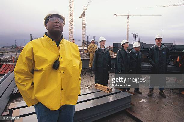 Workers Watching First Structural Steel Being Erected