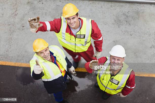workers waving on oil rig - oil worker stock pictures, royalty-free photos & images