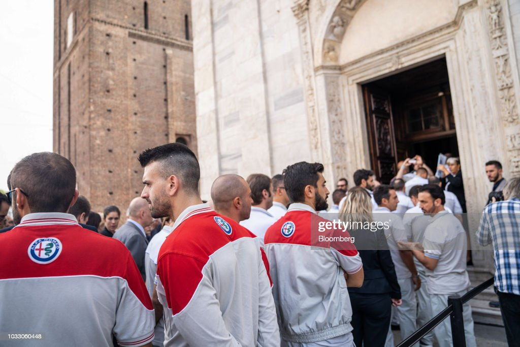 Workers wearing Alfa Romeo uniforms line up to attend a memorial service for former Fiat Chrysler Automobiles NV chief executive officer Sergio Marchionne at the cathedral in Turin, Italy, on Friday, Sept. 14, 2018. Marchionne, the architect of the automaker's dramatic turnaround died, aged 66, on Wednesday, July 25, 2018. Photographer: Federico Bernini/Bloomberg via Getty Images