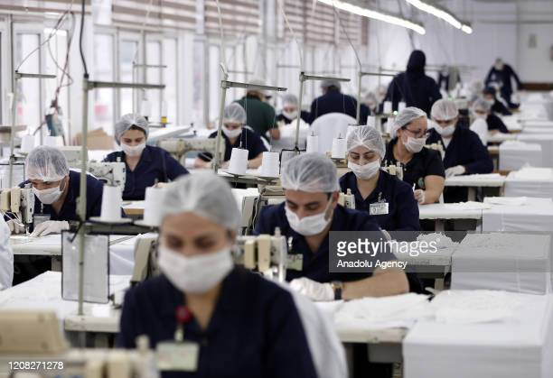 Workers wearing face masks make production of face masks with the instructions of Turkish National Defense Minister Hulusi Akar at the factories and...
