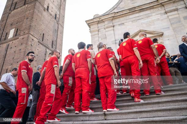 Workers wearing Ferrari uniforms line up to attend a memorial service for former Fiat Chrysler Automobiles NV chief executive officer Sergio...