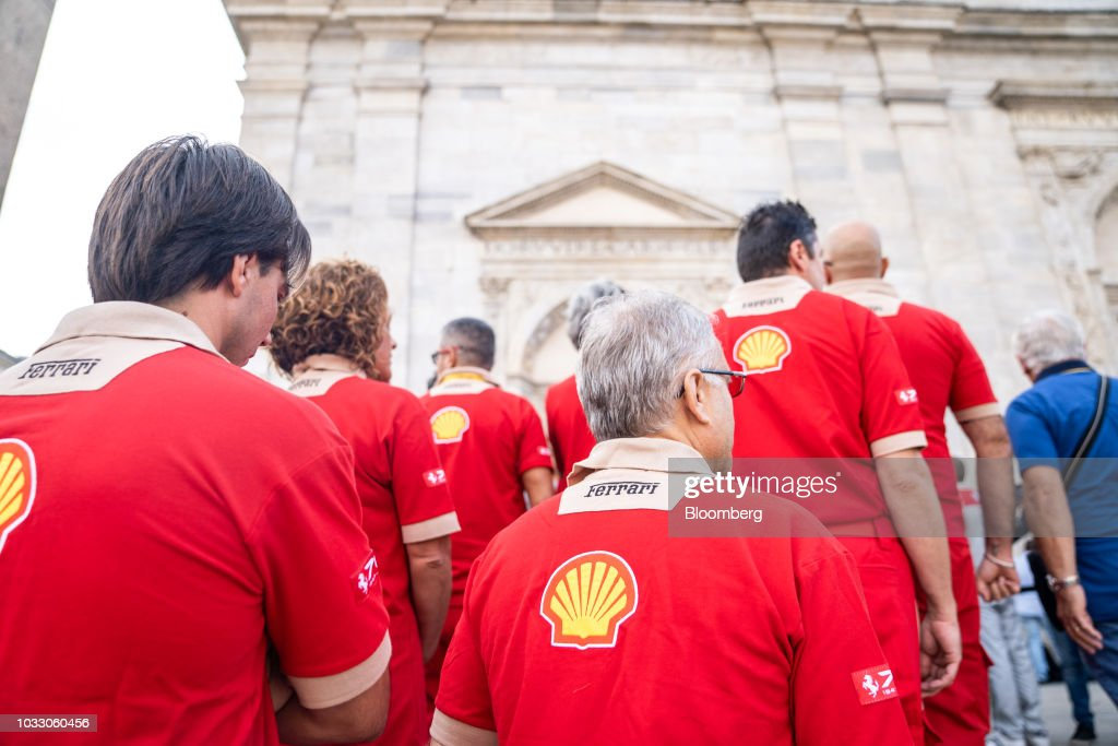 Workers wearing Ferrari uniforms line up to attend a memorial service for former Fiat Chrysler Automobiles NV chief executive officer Sergio Marchionne at the cathedral in Turin, Italy, on Friday, Sept. 14, 2018. Marchionne, the architect of the automaker's dramatic turnaround died, aged 66, on Wednesday, July 25, 2018. Photographer: Federico Bernini/Bloomberg via Getty Images