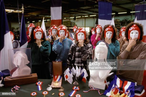 Workers wearing mask at Festa company where busts of Marianne symbol of the French Republic for French town halls are produced in January 1989 in...