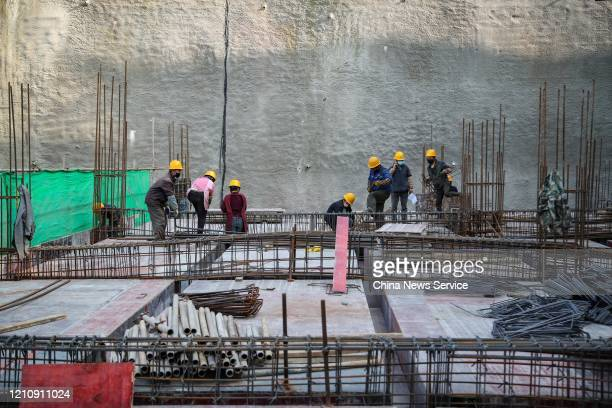 Workers wearing masks at the construction site of Huawei data center at Guian New Area on March 6 2020 in Guiyang Guizhou Province of China